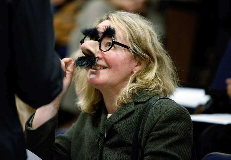 "Professor Carol Greider jokingly dons a pair of ""Groucho"" glasses before a news conference after it was announced that she won the 2009 Nobel Prize in Physiology or Medicine at Johns Hopkins University, Monday, in Baltimore, Maryland. Greider, 48, was recognized by the Royal Swedish Academy of Sciences for her 1984 discovery of telomerase, an enzyme that maintains the length and intergrity of chromosome ends and is critical for the health and survivial of all living cells and organisms. Greider, the Daniel Nathans Professor and Director of Molecular Biology and Genetics in the Johns Hopkins Institute for Basic Biomedical Sciences, shares the prize with Professor Elizabeth Blackburn of the University of California and Jacks Szostack of Harvard Medical School. Photo: Getty Images / Getty Images"