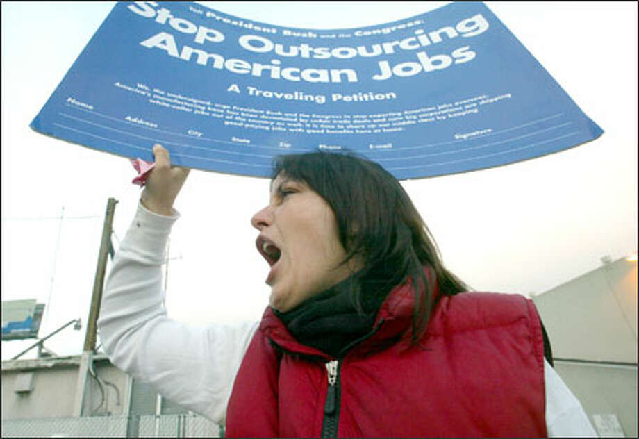 "Rebecca Cooper, a member of the United Steel Workers of America, and other protesters greet commuters with pink slips and signs at the Mercer Street exit off Interstate 5, trying to draw attention to federal policies they say lead U.S. companies to ship jobs overseas. The ""Rescue American Jobs Tour"" is traveling through Washington, Ohio, Minnesota and other states, hoping to log 6,000 miles before the election Nov. 2. Photo: Phil H. Webber, Seattle Post-Intelligencer / Seattle Post-Intelligencer"