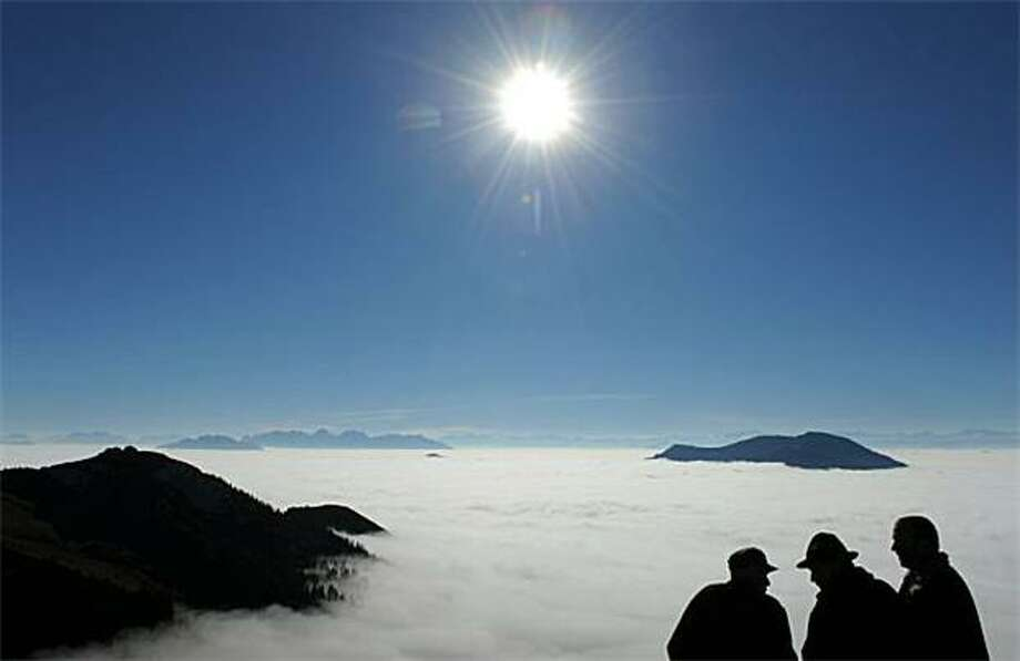 Above the clouds: Hikers rest while climbing the Wendelstein, one of Germany's Mangfall Range - the Bavarian foothills of the Alps. Photo: Christof Stache, AFP / Getty Images / AFP / Getty Images
