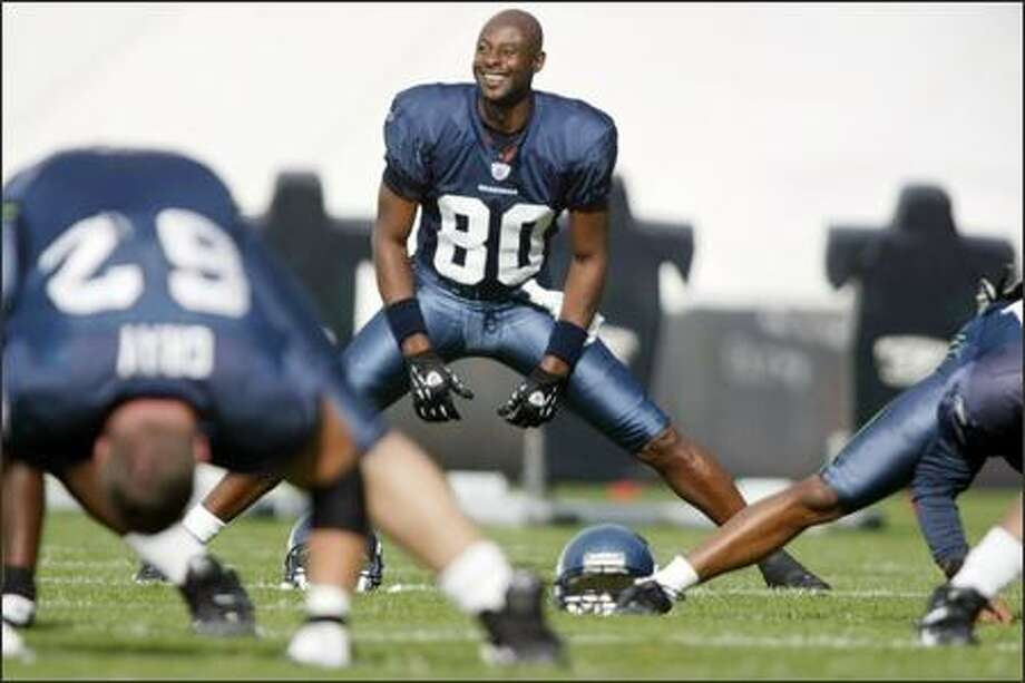 Seahawks' Jerry Rice stretches with his new team during practice in Kirkland. Rice, 42, the NFL career leader in receptions (1,524), receiving yards (22,533) and receiving touchdowns (194), joined the Seahawks on Tuesday from the Oakland Raiders. (Seattle Post-Intelligencer, Joshua Trujillo) Photo: Joshua Trujillo, Seattlepi.com / seattlepi.com