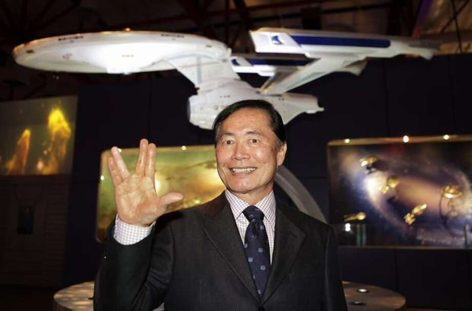 "Actor George Takei, who played the role of helm officer Sulu in the original television series, ""Star Trek,"" gives a ""live long and prosper"" gesture in front of a model of the U.S.S. Enterprise space ship at an exhibit at the Tech Museum in San Jose, Calif., Tuesday. The exhibit opens on Oct. 23 and is one of the largest collection of authentic items from the Star Trek television and movie series. (AP Photo/Paul Sakuma) Photo: AP Photo/WTJV-TV Via Miami Herald / AP Photo/WTJV-TV via Miami Herald"