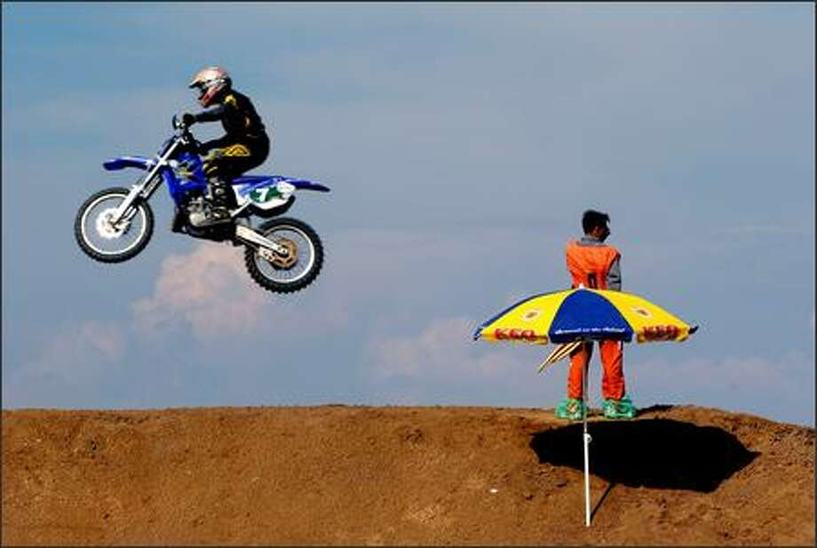 A driver and his motorbike are airborne during a Cyprus national motocross race at Paralimni village southeast of the capital Nicosia, Cyprus, Sunday. (AP Photo/Petros Karadjias)
