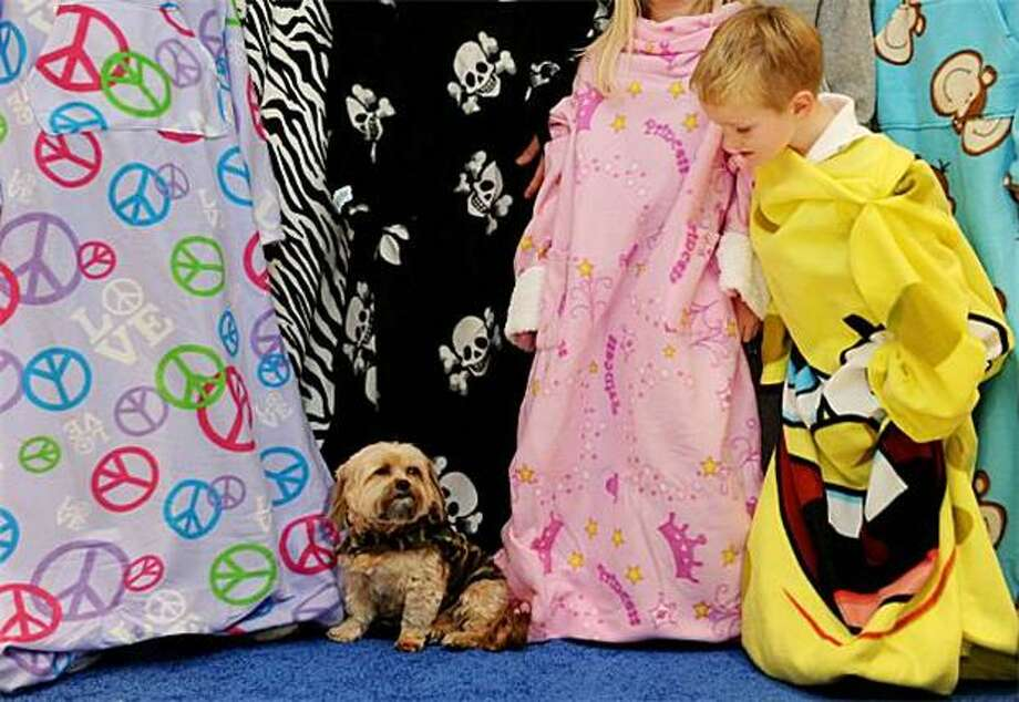 It may be the last Snuggie you ever wear:We get the Love Snuggie, Zebra Snuggie, Sponge Bob Snuggie and even the generic dog Snuggie (worn as a cape). But a Poison Snuggie? (Snuggie Choice Film Awards in New York.) Photo: Stan Honda, AFP / Getty Images / AFP / Getty Images
