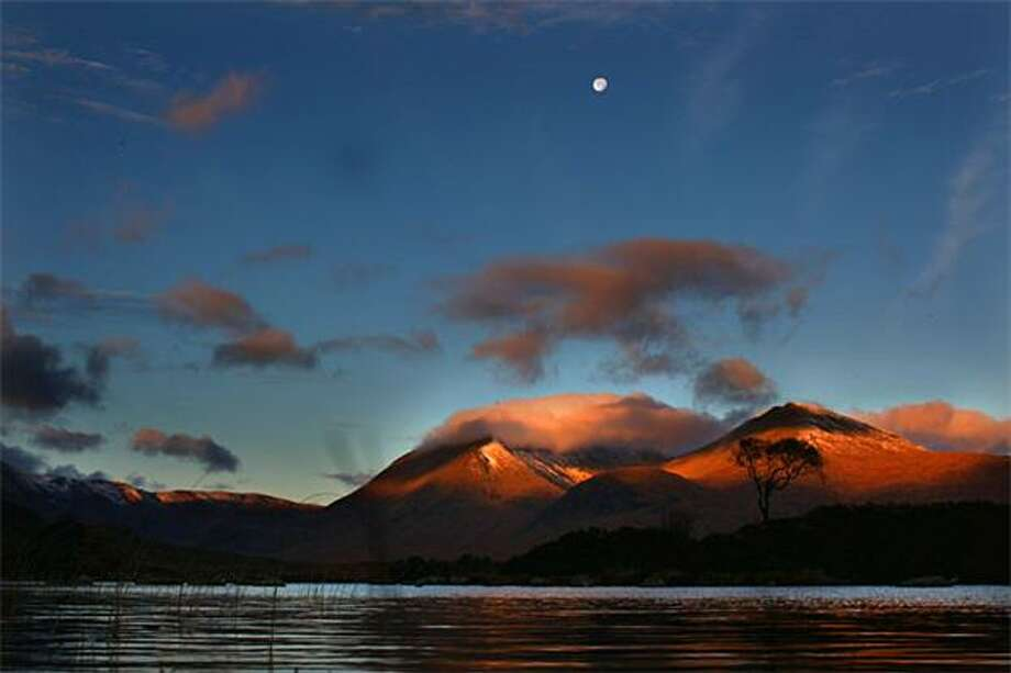 Crowning glory: The rising sun bathes the hills above Lochan na h'Achlaise with light in Rannoch Moor, Scotland. Photo: Jeff J Mitchell, Getty Images / Getty Images