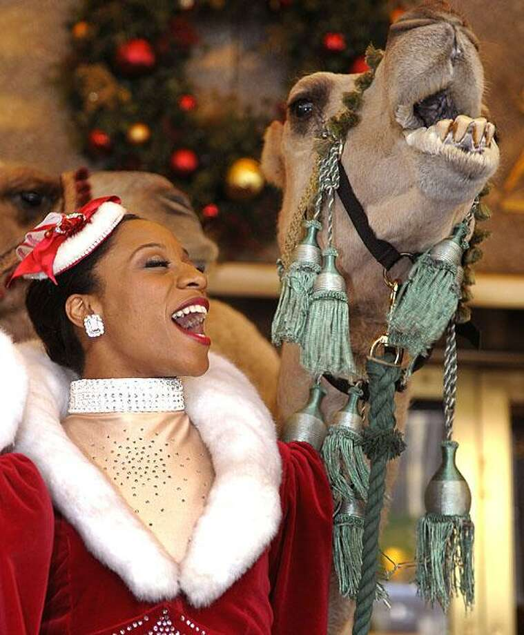 Deck the halls with boughs of holly, fa la la la la la la la la!Rockette Teneise Ellis and a friend belt out a Christmas carol at the Radio City Christmas Spectacular in New York. Photo: Timothy A. Clary, AFP / Getty Images / AFP / Getty Images