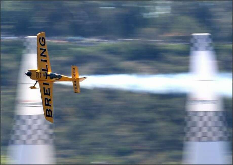 Nigel Lamb of Great Britain flies his aircraft during the final round of the Red Bull Air Race World Series held on the Swan River on Sunday in Perth, Australia. Photo: Getty Images / Getty Images
