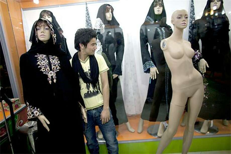 See anything you like?In Herat, Afghanistan, where most women are clothed head to ankle, a young man gets an eyeful of naked mannequin. Photo: Majid Saeedi, Getty Images / Getty Images