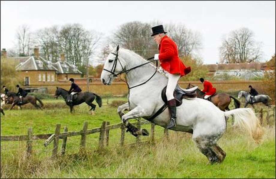 A huntsman riding with the Bicester with Whaddon Chase hunt, clears a fence near Stratton Audley, England, on the first day of the last-ever hunting season. Legislation before parliament is expected to outlaw hunting in the near future. (AP Photo/Fiona Hanson-pa) Photo: Courtesy Of Le Family / Courtesy of Le family