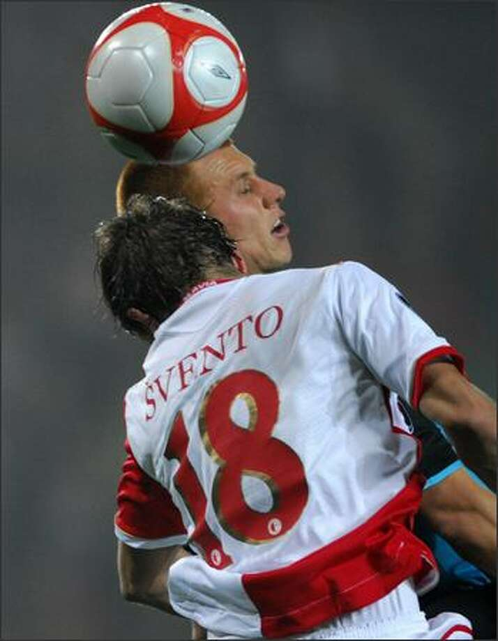 Dusan Svento, left, of SK Slavia Prague and Steve Sidewell of Aston Villa FC vie for a ball during their UEFA Cup match between SK Slavia Prague and Aston Villa FCon on Thursday. Photo: Getty Images / Getty Images