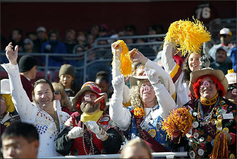 Washington Redskins fans decked out as pigs and Elvis were in hog heaven as they watched their team beat the Seattle Seahawks 27-20. Photo: Scott Eklund, Seattle Post-Intelligencer / Seattle Post-Intelligencer