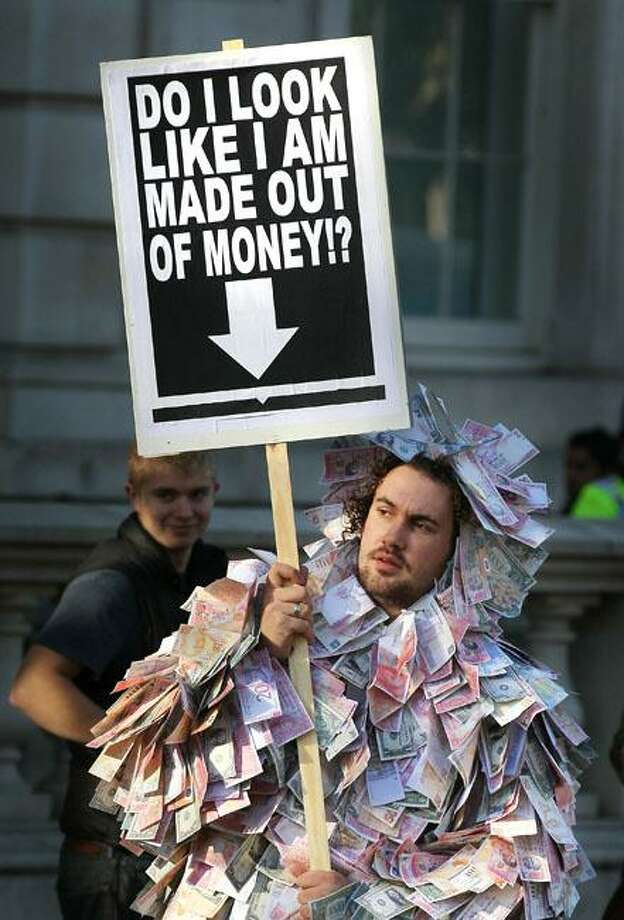 Freshman year you always put on a few pounds:A student protests a steep increase in university tuition outside Parliament in London. Britain has proposed charging as much as $14,000 tuition a year, up from the current cap of $5,264. Photo: Peter Macdiarmid, Getty Images / Getty Images