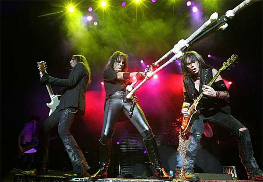 "A microphone stand? Yao Ming's crutch? We have no idea what Alice Cooper is playing during his ""Theatre Of Death"" Tour at the Jahrhunderthalle in Frankfurt, Germany. Photo: Daniel Roland, AFP / Getty Images / AFP / Getty Images"