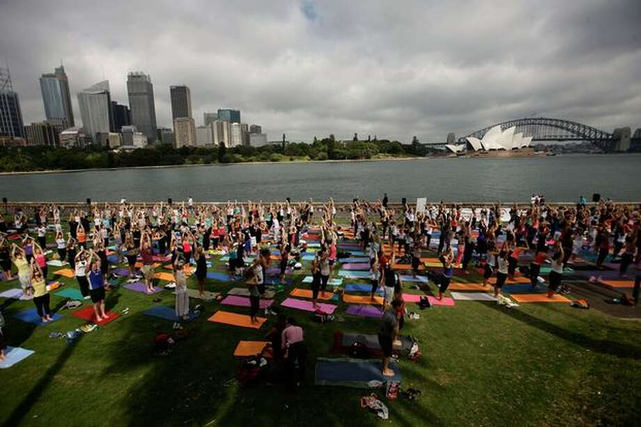 Yogis take part in the Yoga Aid Sydney Challenge 2009 at Mrs Macquaries Point in the Royal Botanic Gardens Sydney on Sunday in Sydney, Australia. The event, which will happen in cities throughout Australia, sees participants perform 108 sun salutations in 108 minutes in order to raise money for charity. Photo: Getty Images / Getty Images