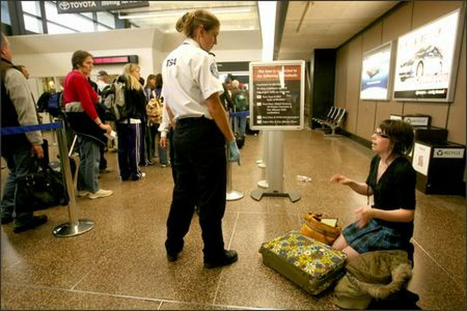 "Brittaney Davis, 19, of Seattle had to get out of the security line Thursday at Sea-Tac International Airport because she had items she couldn't take on board her flight, so she had to check her bag. ""I've never done this before, and I didn't realize that taking hair gel on the plane was a problem,"" said Davis, a first-time flier who was travelling to California to visit her boyfriend. Photo: Scott Eklund, Seattle Post-Intelligencer / Seattle Post-Intelligencer"