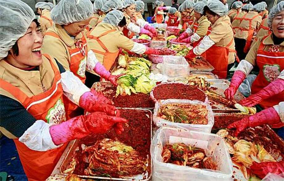 Fermenting social change? Thousands of housewives make Kimchi for donation to the poor in preparation for winter in Seoul, South Korea. Kimchi is a traditional Korean dish of fermented vegetables usually mixed with chili. Photo: Chung Sung-Jun, Getty Images / Getty Images