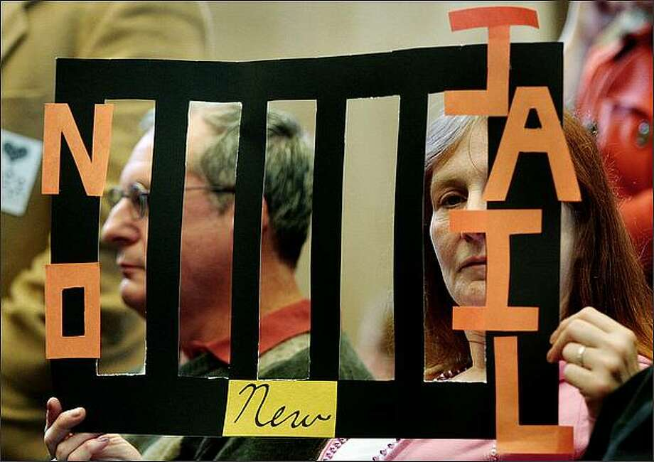 Eileen A. Lorrekovich, a treatment advocate, was among a group of people displaying her opposition to a new municipal jail during a City Council budget meeting at City Hall in Seattle. Photo: Dan DeLong, Seattle Post-Intelligencer / Seattle Post-Intelligencer