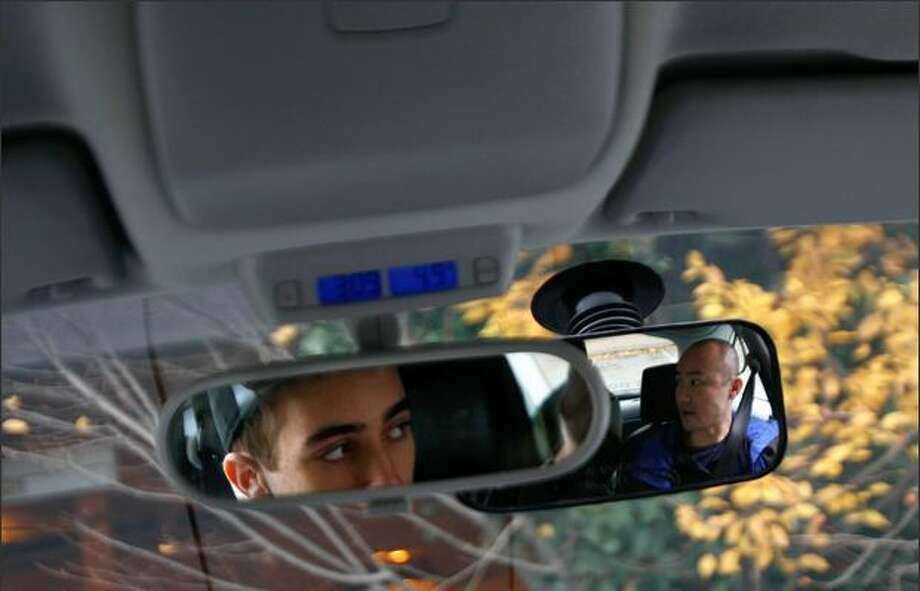 Zach Krofchek, 16, listens to 911 Driving School instructor Paul Chung on Sunday before his fourth practice drive -- this time on the highway. Photo: Andy Rogers, Seattle Post-Intelligencer / Seattle Post-Intelligencer