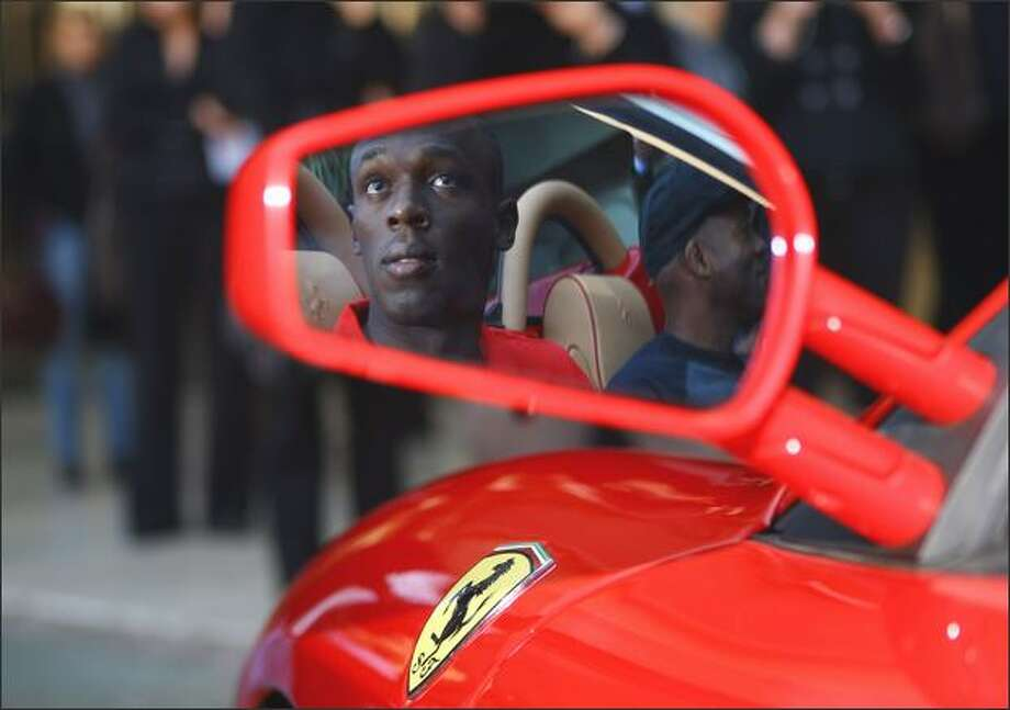 Usain Bolt of Jamaica goes for a drive in a Ferrari in the streets of Monaco before the IAAF World Athletics Gala at the Hotel on Sunday in Monte Carlo, Monaco. Photo: Getty Images / Getty Images