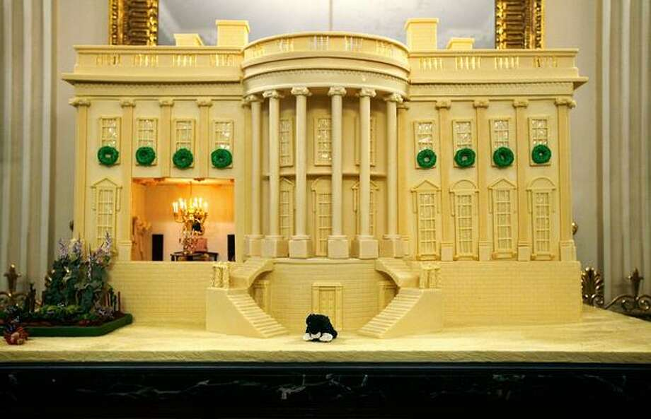 "The annual gingerbread house sits in the State Dining Room during the media preview of the White House holiday decorations, Tuesday, at the White House in Washington, DC. The theme for the 2009 White House holiday decorations is ""Reflect Rejoice Renew."" Photo: Getty Images / Getty Images"