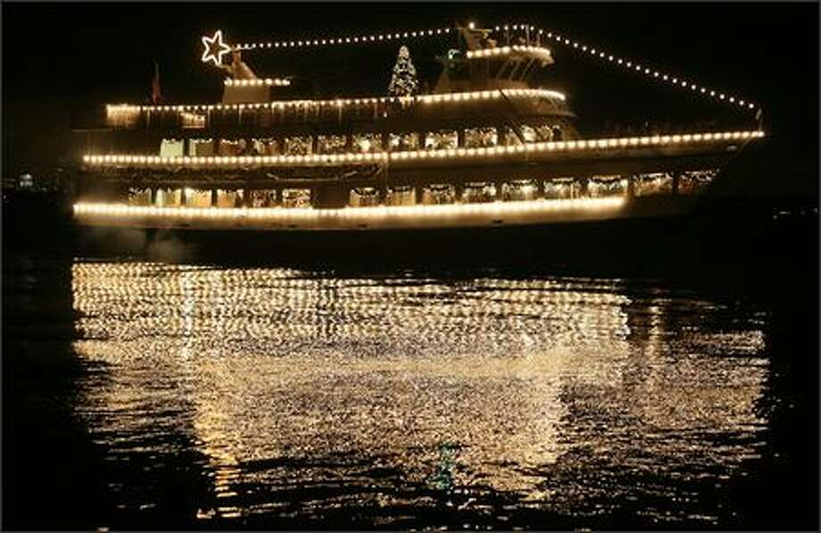 The Argosy ship Spirit of Seattle departs from the docks at the Leschi Marina for a cruise Monday around Lake Washington. Running every night through Dec. 23, the 57th annual festival brings the holiday spirit to more than 45 shoreline communities. Photo: Mike Urban, Seattle Post-Intelligencer / Seattle Post-Intelligencer