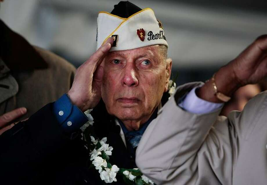 "Aaron Chabin of New York, a U.S. Army veteran who was serving at Pearl Harbor when it was attacked on December 7, 1941 salutes during a ceremony marking the 68th anniversary of the event on the USS Intrepid Monday in New York City. Veterans groups around the country hold ceremonies every year in December on the day that President Franklin Roosevelt predicted would ""live in infamy"". Photo: Getty Images / Getty Images"