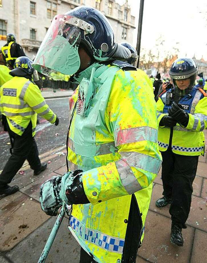 Apparently they were art majors:A London riot policeman takes a break after clashing with university students protesting hefty tuition fee increases outside of Parliament. Photo: Ben Stansall, AFP / Getty Images / AFP / Getty Images