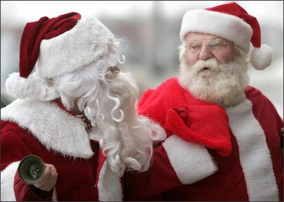Ryan Bakken, left, and Albert Trenda, dressed as Santa Claus, exchange greetings outside a craft store Friday in Grand Forks, N.D. Bakken, a Grand Forks Herald columnist, was ringing a bell and taking donations for the Salvation Army when Trenda dropped by. Photo: Ava Gerlitz / Ava Gerlitz