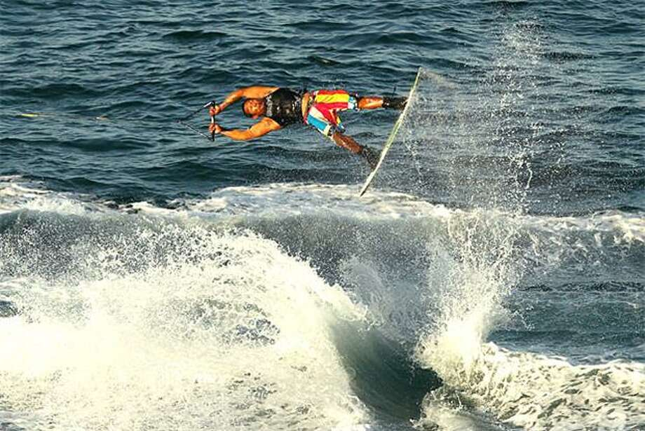 Shake and bake off the wake: Bunyalo Jumruang of Thailand launches himself over the churning foam in the Wakeboarding Final at the 2nd Asian Beach Games in Muscat, Oman. Photo: Ryan Pierse, Getty Images / Getty Images