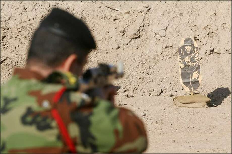 An Iraqi soldier shoots at a target on a firing range during a training session run with the advice and support of British soldiers (unseen) at a location in the north of the southern Basra province on December 18, 2008. Photo: Getty Images / Getty Images