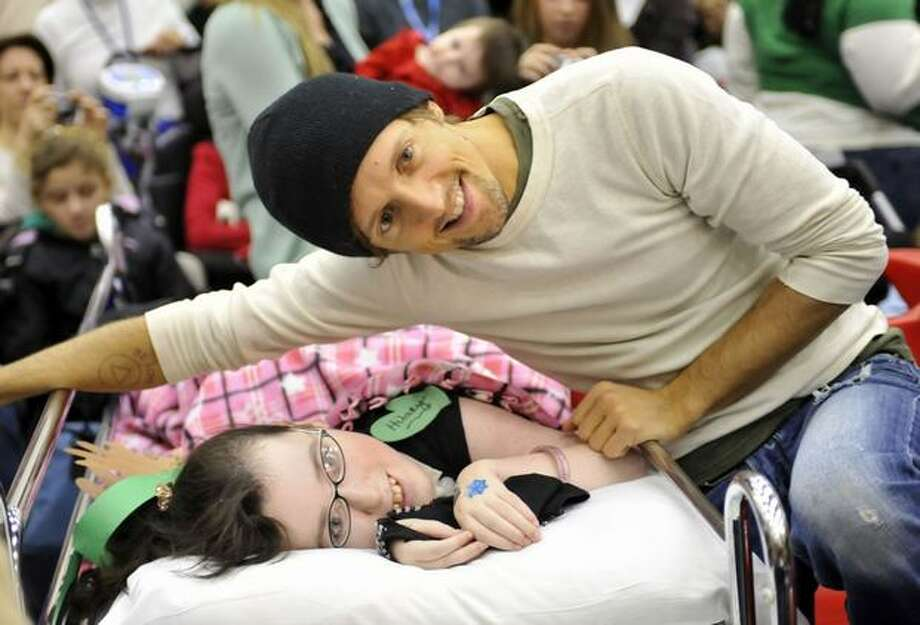 Jason Mraz visits with patients at the 95.5 WPLJ-FM 18th Annual Scott & Todd Live Boradcast at Blythedale Children's Hospital on Monday in Valhalla, New York. Photo: Getty Images / Getty Images