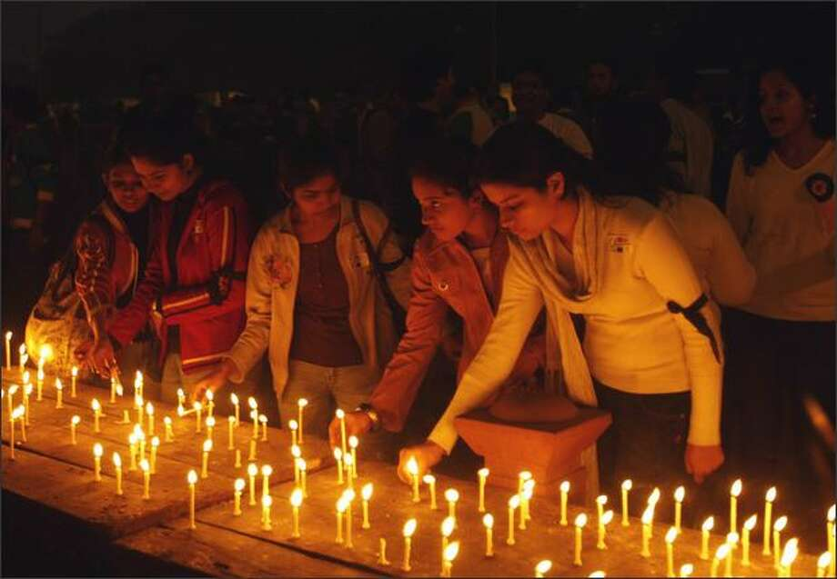 Indian students light candles during a peace rally outside Rajghat, at a memorial for Mahatma Gandhi in New Delhi on Sunday. Chartered accountant students organized a march against terrorism. Photo: Getty Images / Getty Images