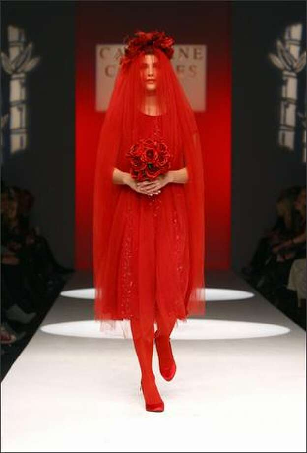 A model walks down the catwalk during the Caroline Charles show as part of London Fashion Week fall/winter 2009 on Friday, Feb. 20, 2009 in London. Photo: Getty Images / Getty Images