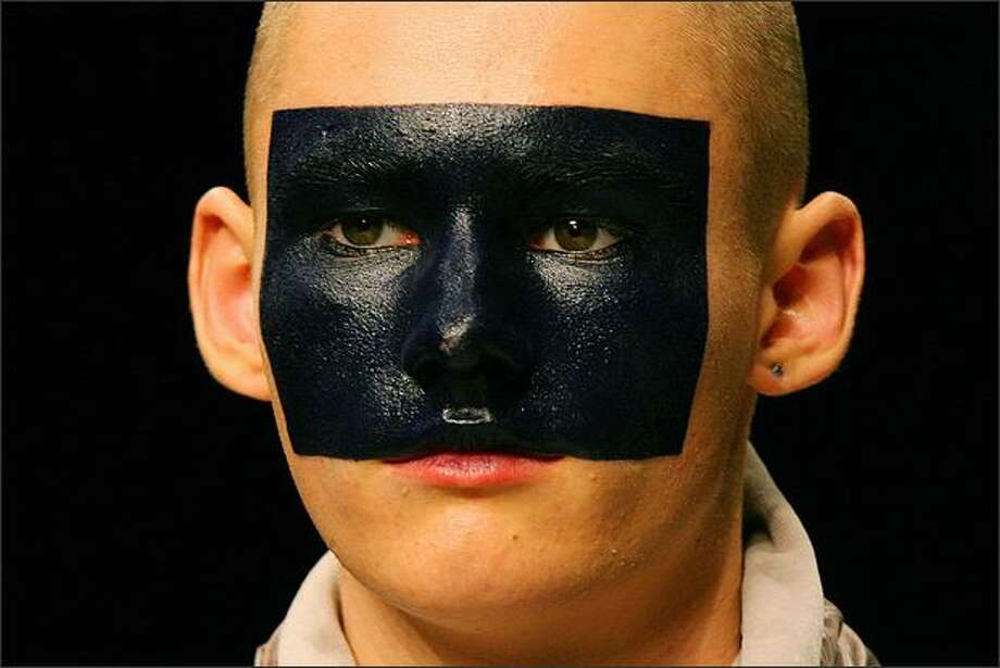 A model wears face paint during a show by fashion designer Christopher Shannon during the Autumn/Winter 2009 show on the last day of London Fashion Week, on Wednesday. Photo: Getty Images / Getty Images
