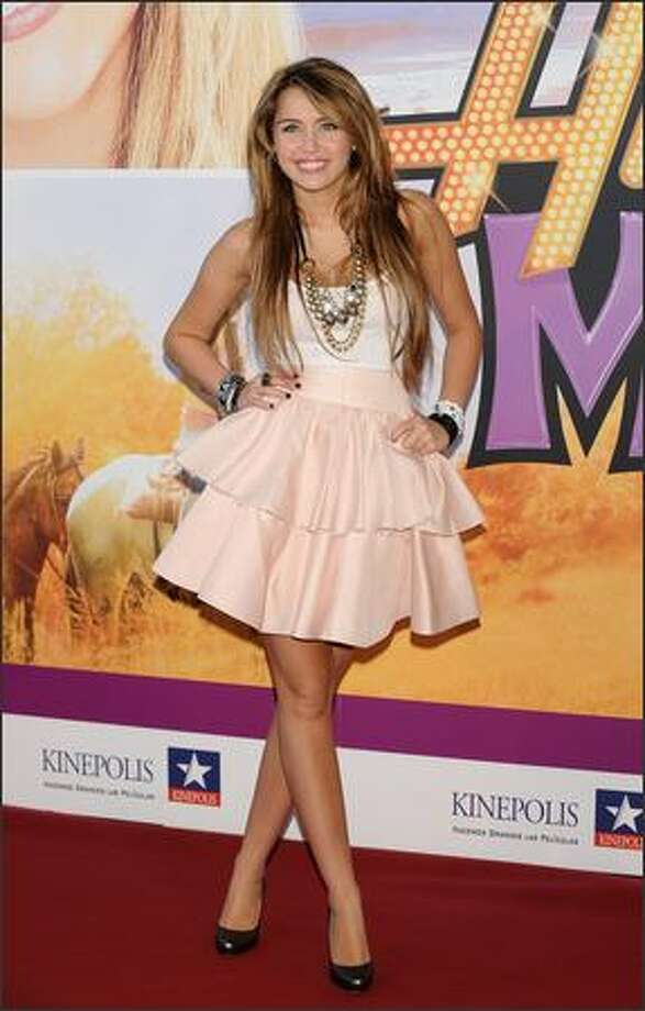 "Actress Miley Cyrus attends the premiere of ""Hannah Montana: The Movie"" at the Kinepolis cinema in Madrid, Spain on Tuesday, April 21, 2009. Photo: Getty Images / Getty Images"