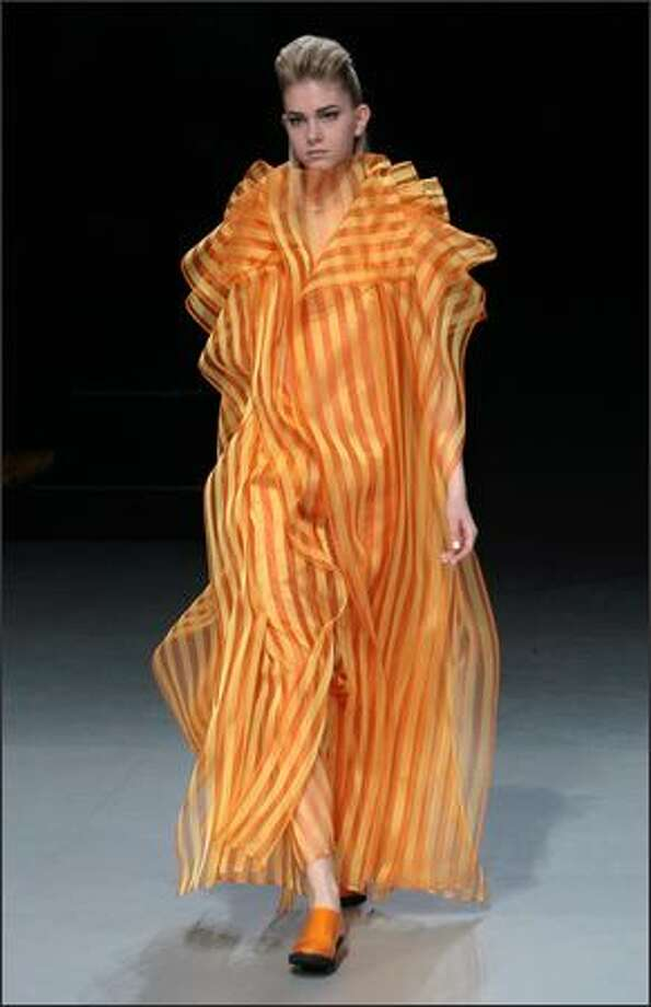 A model presents a creation by Japanese designer Dai Fujiwara for Issey Miyake. Photo: Getty Images / Getty Images