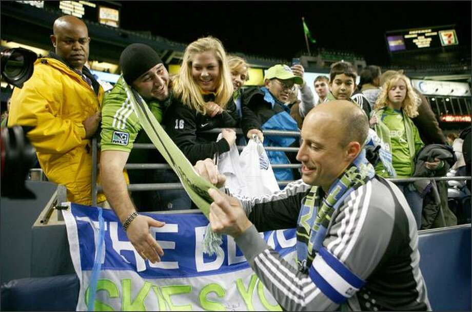 Sounders FC goalkeeper Kasey Keller signs autographs for fans after the team's season opener at Qwest Field. Photo: Joshua Trujillo, Seattlepi.com / seattlepi.com