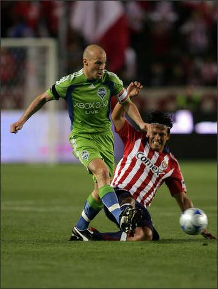 Freddie Ljungberg of Seattle Sounders FC gets off a pass as Eduardo Lillingston of Chivas USA slides in for the tackle in the first half during an MLS match at The Home Depot Center in Carson, Calif., on Saturday, April 18, 2009. Photo: Getty Images / Getty Images