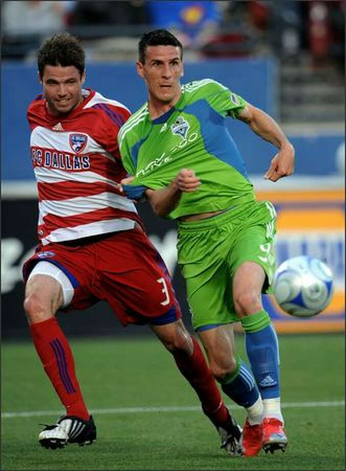 Forward Sebastien Le Toux #9 of the Seattle Sounders FC dribbles the ball past Drew Moor #3 of FC Dallas at Pizza Hut Park in Frisco, Texas on Saturday, May 16, 2009. Photo: Getty Images / Getty Images