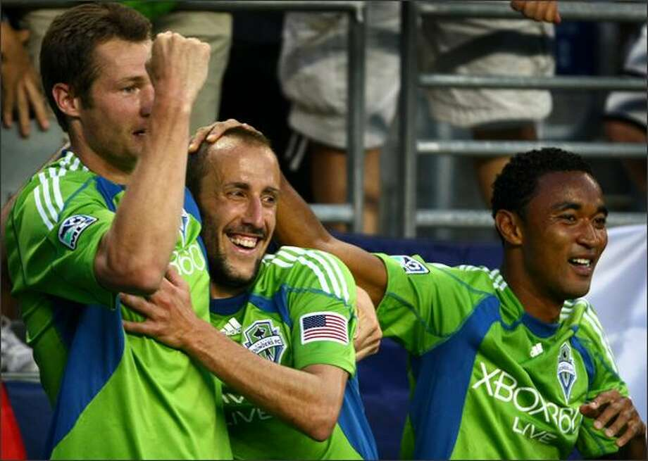 Seattle Sounders players, from left, Nate Jaqua, Peter Vagenas and James Riley celebrate Jaqua's second-half goal against Columbus Crew during a match at Qwest Field in Seattle on Saturday, May 30, 2009. Photo: Joshua Trujillo, Seattlepi.com / seattlepi.com