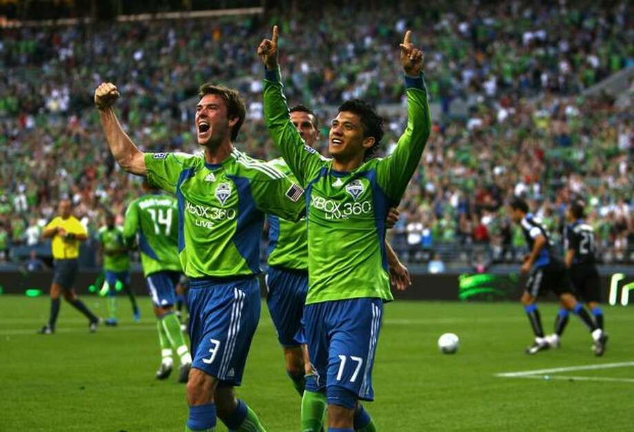 Sounders Brad Evans (left) and Fredy Montero celebrate after Montero's second-half goal that gave Seattle a 2-0 lead. Photo: Joshua Trujillo, Seattlepi.com / seattlepi.com