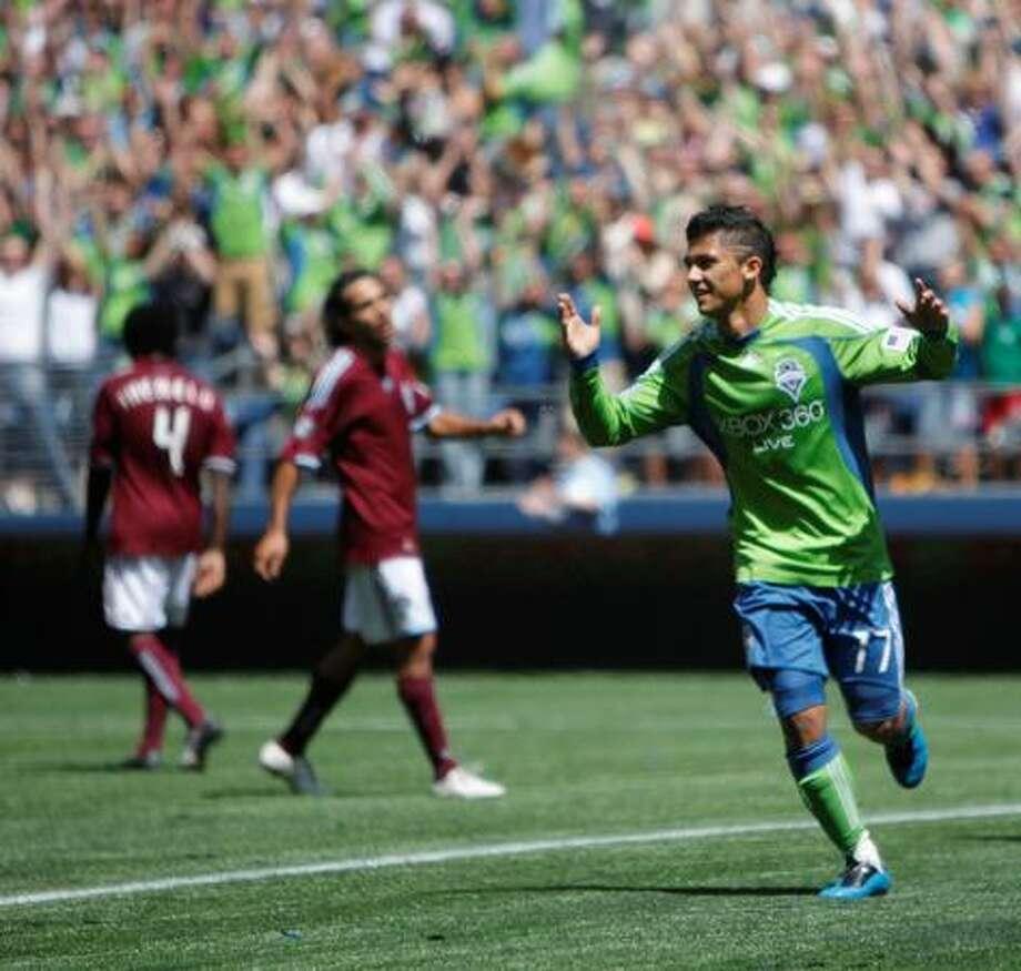 Fredy Montero pumps up the fans after a Sounders score. Photo: Clifford DesPeaux, Seattlepi.com / seattlepi.com