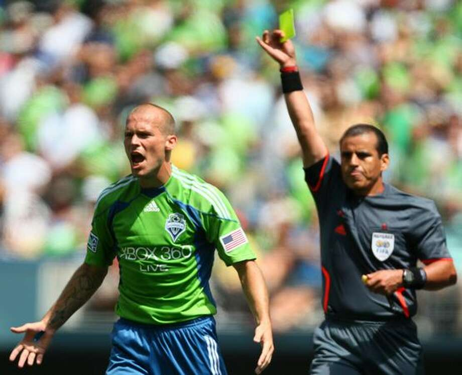 Seattle Sounders player Freddie Ljungberg reacts to a yellow card from referee Baldomero Toledo during the second half against Chicago Fire. Ljungberg's reaction led to a red card and ejection from the game on Saturday July 25, 2009 at Qwest Field in Seattle. Photo: Joshua Trujillo, Seattlepi.com / seattlepi.com