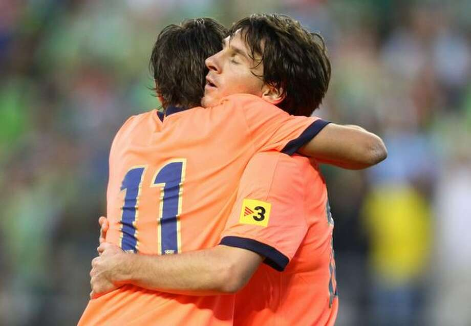 FC Barcelona's Lionel Messi, right, is congratulated by teammate Bojan Krkic after scoring a goal in the first half. Photo: Joshua Trujillo, Seattlepi.com / seattlepi.com