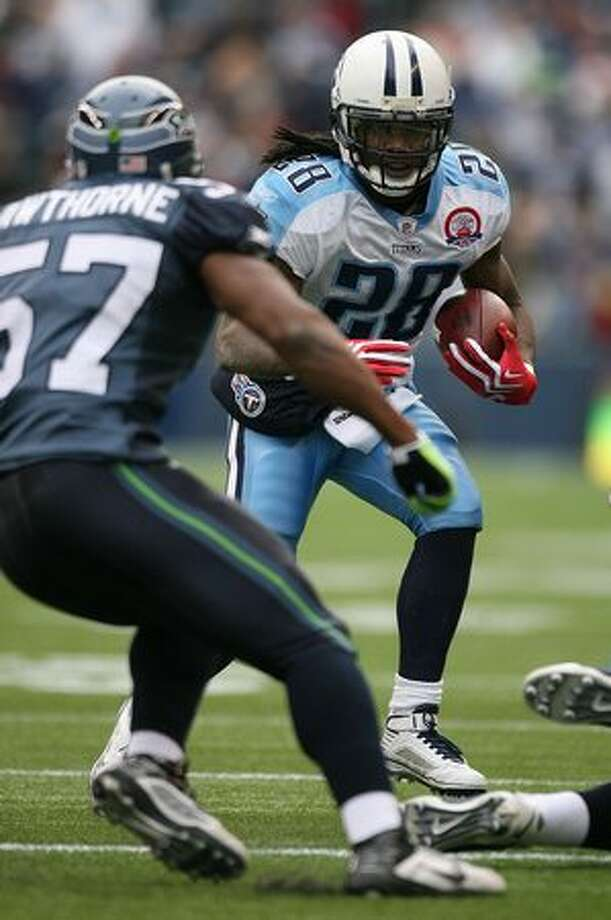Running back Chris Johnson #28 of the Tennessee Titans rushes against David Hawthorne #57 of the Seattle Seahawks at Qwest Field in Seattle. Photo: Getty Images / Getty Images