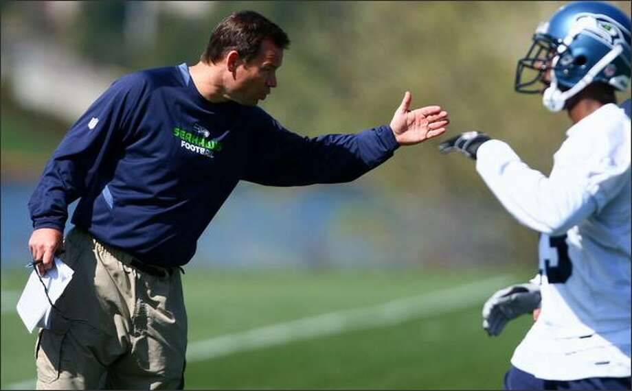 Seahawks head coach Jim Mora barks commands to his team at practice at the Virginia Mason Athletic Center in Renton. Photo: Joshua Trujillo, Seattlepi.com / seattlepi.com