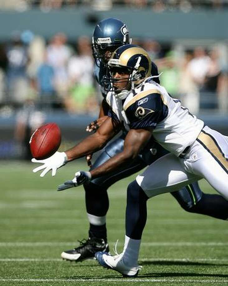 Wide receiver Donnie Avery of the St. Louis Rams makes a catch against Leroy Hill of the Seahawks in the season opener for both teams on Sunday, Sept.13, 2009 at Qwest Field in Seattle. Photo: Getty Images / Getty Images