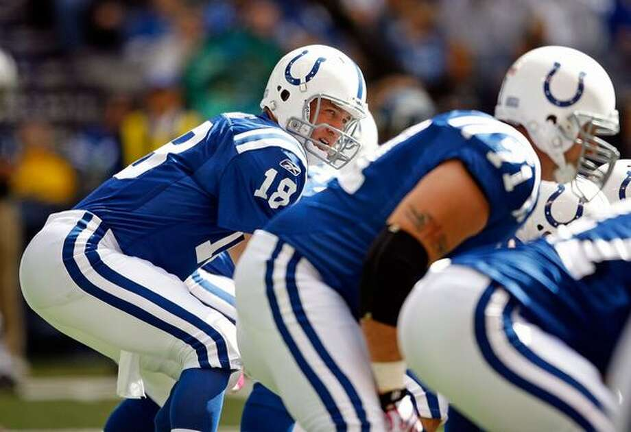 Peyton Manning #18 of the Indianapolis Colts is pictured during the NFL game against the Seattle Seahawks at Lucas Oil Stadium on October 4, 2009 in Indianapolis, Indiana. The Colts won 34-17. Photo: Getty Images / Getty Images