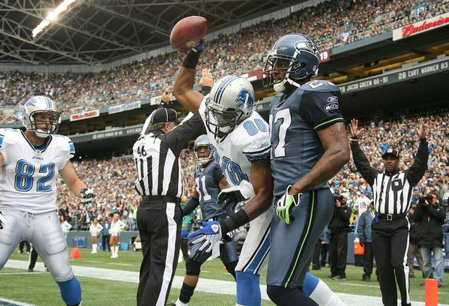 Wide receiver Bryant Johnson #80 of the Detroit Lions spikes the ball after scoring a touchdown against Jordan Babineaux #27 of the Seattle Seahawks. Photo: Getty Images / Getty Images
