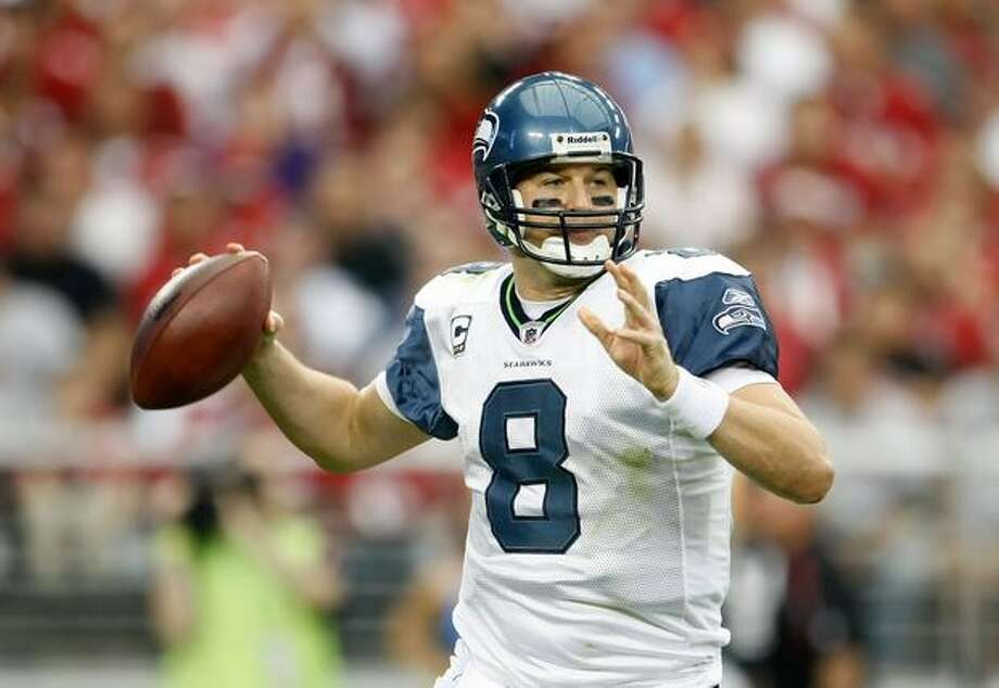 Quarterback Matt Hasselbeck #8 of the Seattle Seahawks drops back to pass against the Arizona Cardinals in the first half. Photo: Getty Images / Getty Images
