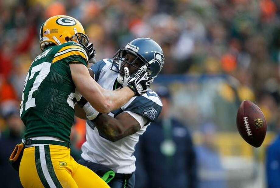 Marcus Trufant #23 of the Seattle Seahawks interfers with a catch attempt by Jordy Nelson #87 of the Green Bay Packers. The Packers defeated the Seahawks 48-10. Photo: Getty Images / Getty Images